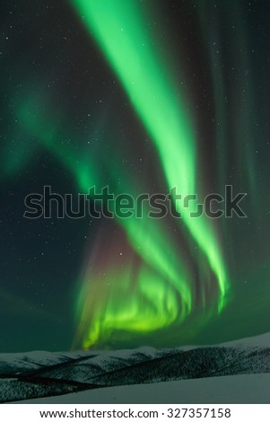 Aurora Borealis and winter landscape - stock photo