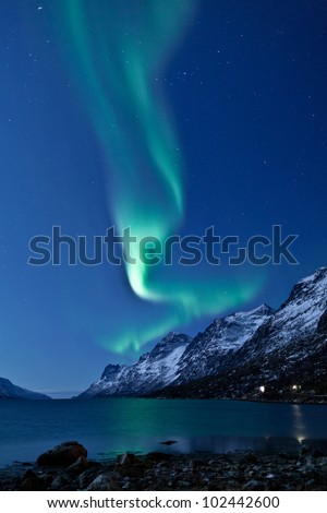 Aurora Borealis in Norway reflecting in the water - stock photo