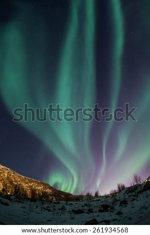 Aurora Borealis (Northern lights) near Tromso, Norway - stock photo