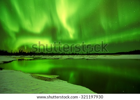Aurora Borealis Northern Lights reflections in lake in Fairbanks Alaska  - stock photo
