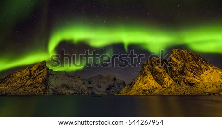 Aurora borealis (Polar lights). View to Steinfjord on Senja island - Lofoten islands, Norway