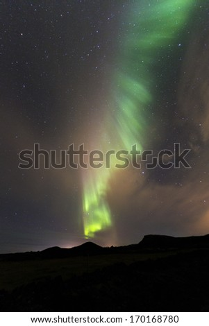 Aurora curtains overhead in Iceland - stock photo