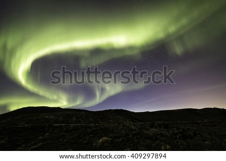 Auroras over the Reykjanes peninsula in Iceland in April - stock photo