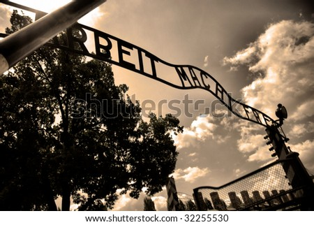 Auschwitz gate entrance. Old style photo of Auschwitz camp - stock photo