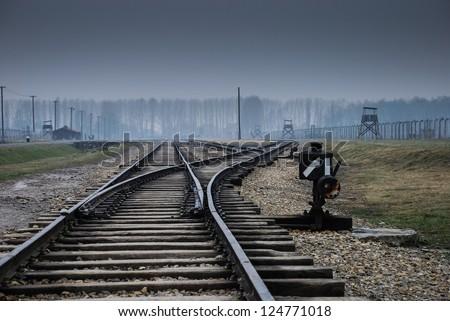 Auschwitz in Winter Fog Train Track - stock photo