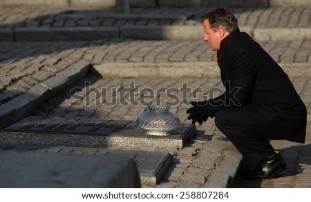 AUSChWITZ, POLAND - DECEMBER 10, 2014: British Prime Minister David Cameron during the visit in the Nazi concentration camp Auschwitz -- Birkenau. Poland - stock photo