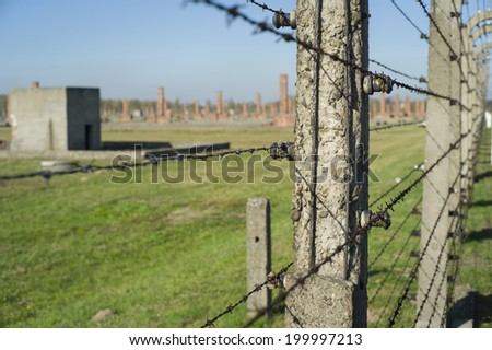 AUSCHWITZ, POLAND - OCT 29: The fence and the houses of the infamous Auschwitz II-Birkenau, a former Nazi extermination camp and now a museum on October 29, 2013 in Oswiecim, Poland