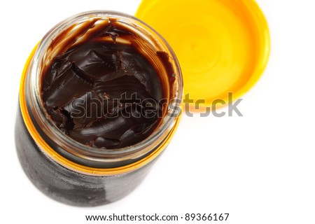 Aussie vegemite, complete with toast crumbs. Isolated on white.