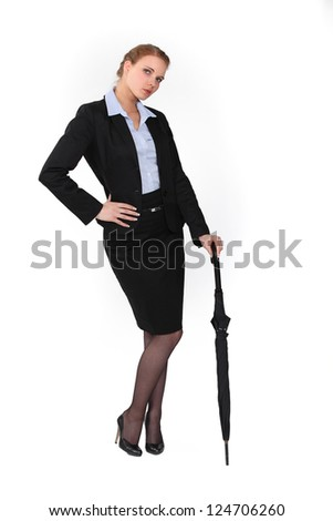Austere businesswoman holding an umbrella - stock photo