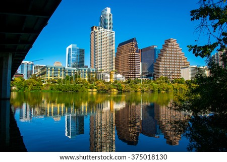 Austin City Lights at Night 2016 Aerial View Over ATX Austin Texas with Downtown Skyline in the background with Roads and cars driving creating great perspective of Capital Cities Austin , TX - stock photo