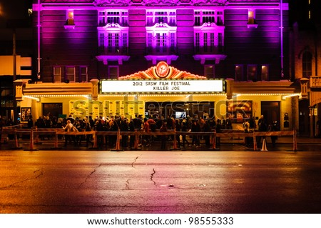 AUSTIN - MARCH 26: People gather for a red carpet gathering under a SXSW marquee at the Paramount Theater on March 26, 2012 in Austin, Texas.
