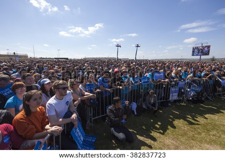 AUSTIN, TEXAS - FEBRUARY 27, 2016: A crowd of people listen to Bernie Sanders speak during a campaign rally at the Circuit of the Americas.