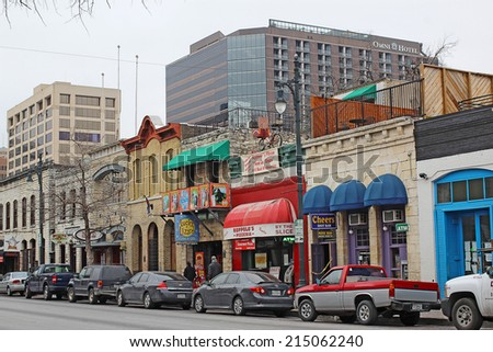 AUSTIN, TEXAS - FEBRUARY 3 2014: Bars, restaurants and other businesses in the Sixth Street Historic District, a major tourist destination that is listed in the National Register of Historic Places. - stock photo