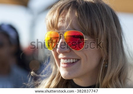 AUSTIN, TEXAS - FEBRUARY 27, 2016: The line waiting to enter the Circuit of the Americas for a Bernie Sanders campaign rally is reflected in the sunglasses of Lauren Hartnett.