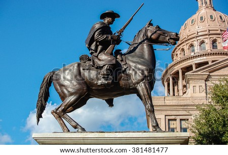 AUSTIN, TEXAS - February 1, 2012: The statue of Terry's Texas Ranger with the Texas state capitol building and US flag in background