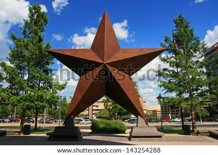 AUSTIN,TEXAS-JUL 19: Big star decorated in the city against blue sky on July 19, 2008 in Austin, Texas, USA. Austin, capital city of Texas state settled in 1835, is the 11th most populous city in US. - stock photo