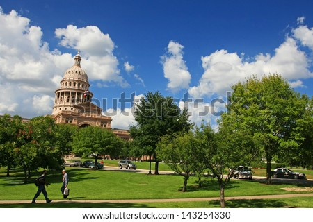 AUSTIN,TEXAS-JUL 19: Unidentified people walk at Texas state capitol in Austin, Texas on July 19, 2008. Capitol has 360,000 square ft. of floor space, more than any other state capitol building. - stock photo