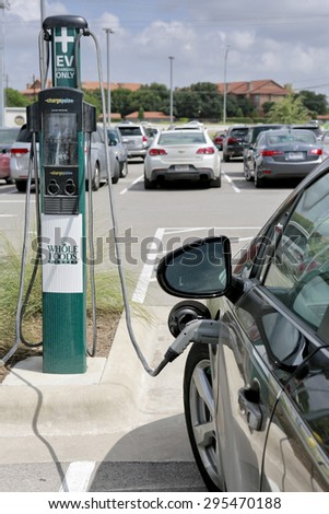 Austin, Texas,  July 10, 2015 Whole Foods electric vehicle charging station. Whole Foods Market is an American foods supermarket chain specializing in organic food, headquartered in Austin, Texas  - stock photo