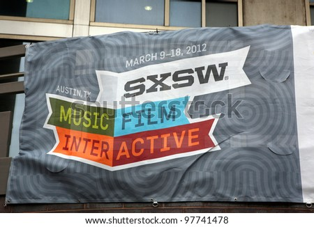 AUSTIN, TEXAS - MAR 9: SXSW 2012 South by Southwest 2012 Annual music, film, and interactive conference and festival on March 9, 2012 in Austin, Texas. Festival is held from March 9-18. Poster on building - stock photo