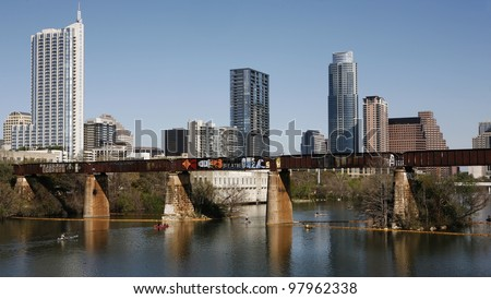 AUSTIN, TEXAS - MAR 9: SXSW 2012 South by Southwest 2012 Annual music, film, and interactive conference and festival on March 9, 2012 in Austin, Texas. Festival is held from March 9-18. Austin Skyline, Colorado River and railway bridge