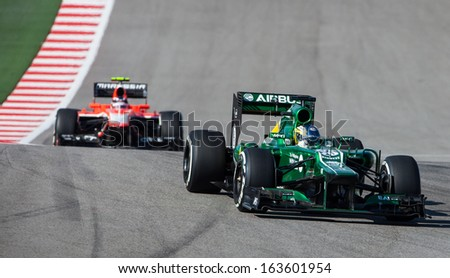AUSTIN, TEXAS - NOVEMBER 17. Charles Pic of Team Caterham leading of Team Marussia during the  Formula 1 United States Grand Prix on November 17, 2013 in Austin, Texas - stock photo