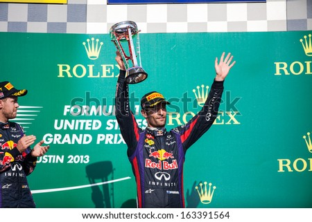 AUSTIN, TEXAS - NOVEMBER 17.  Mark Webber holding up his third place trophy on the podeum after the Formula 1 United States Grand Prix on November 17, 2013 in Austin, Texas.  - stock photo