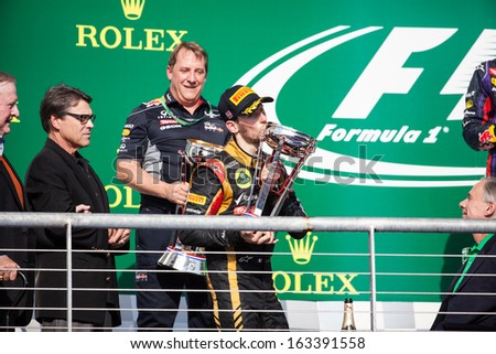 AUSTIN, TEXAS - NOVEMBER 17. Romain Grosjean kissing his 2nd place trophy on the podeum after the Formula 1 United States Grand Prix on November 17, 2013 in Austin, Texas.  - stock photo