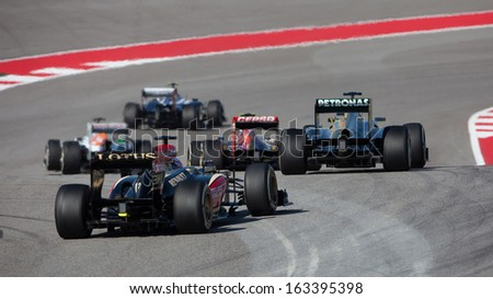 AUSTIN, TEXAS - NOVEMBER 17. Tails of F1 cars after Turn 1 at the start of the Formula 1 United States Grand Prix on November 17, 2013 in Austin, Texas.  - stock photo
