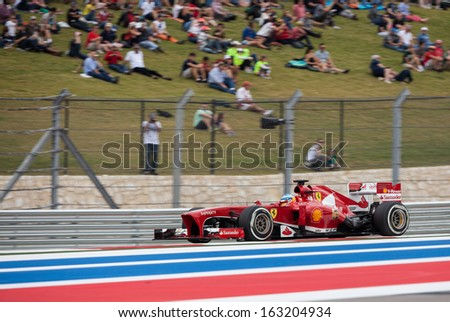 AUSTIN, TEXAS � NOVEMBER 16.  Team Ferrari races in the Formula One Qualifying Session at the Circuit of the America's race track on November 16, 2013 in Austin, Texas. - stock photo