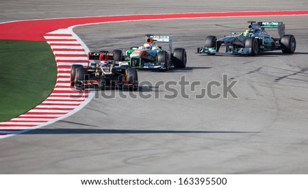 AUSTIN, TEXAS - NOVEMBER 17.  Team Lotus, Team Force India and Team Mercedes together after rounding Turn 12 during the Formula 1 United States Grand Prix on November 17, 2013 in Austin, Texas. - stock photo