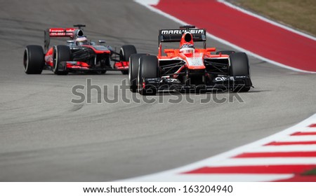 AUSTIN, TEXAS � NOVEMBER 16.  Team Marussia ahead of Team McLaren in the Formula One Qualifying Session at the Circuit of the America's race track on November 16, 2013 in Austin, Texas. - stock photo
