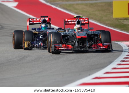 AUSTIN, TEXAS - NOVEMBER 17.  Team McLaren ahead of Team Toro Rossol during the Formula 1 United States Grand Prix on November 17, 2013 in Austin, Texas. - stock photo