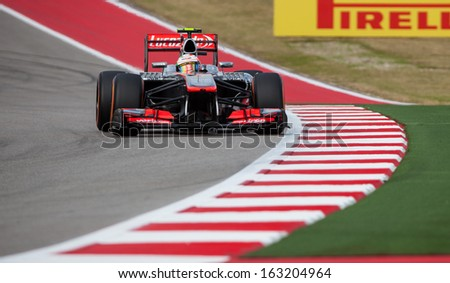 AUSTIN, TEXAS � NOVEMBER 16.  Team McLaren races in the Formula One Qualifying Session at the Circuit of the America's race track on November 16, 2013 in Austin, Texas. - stock photo