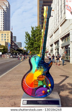 "AUSTIN, TEXAS - NOVEMBER 18 : "" Vibrancy""  by Craig Hein, one of the Guitar town Austin art project Guitars on Congress Ave. as seen during the Formula One Fan Fest November 18 2012. - stock photo"