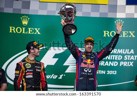 AUSTIN, TEXAS - NOVEMBER 17.  Winner Sebastian Vettel holding up his trophy on the podeum after the Formula 1 United States Grand Prix on November 17, 2013 in Austin, Texas.  - stock photo