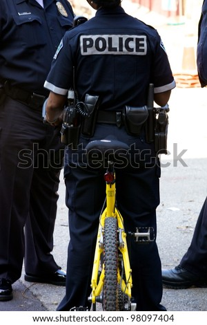 AUSTIN, TX - MAR 12: SXSW Interactive Conference on March 12, 2012 in Austin.Police uses bicycle during the SXSW Interactive Conference in Austin. - stock photo