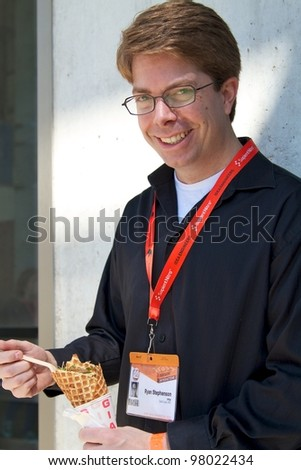 AUSTIN, TX - MAR 12: SXSWi 2012. SXSW Interactive Conference on March 12, 2012 in Austin, Texas. Attendee eating ice cream - stock photo