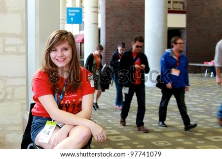 AUSTIN, TX - MAR 12: SXSWi 2012. SXSW Interactive Conference on March 12, 2012 in Austin, Texas. A young volunteer greets visitors for the SXSWi Conference in the Austin Convention Center. She is volunteering for 6 days during the event.