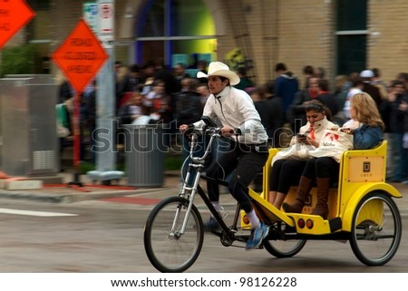 Austin, TX - March 9: SXSW Interactive Conference in Austin.   Austin Pedicabs are in high demand during the conference - stock photo
