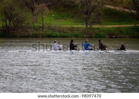 Austin, TX - March 9: SXSW Interactive Conference in Austin. Rolling team practices on Lady Bird Lake. - stock photo
