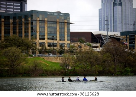 Austin, TX - March 9: SXSW Interactive Conference in Austin.   Rolling team practices on Lady Bird Lake - stock photo