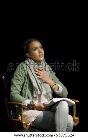 AUSTIN,TX - OCTOBER 24:  Jessica Alba looks up at something at ' The Hand Job ' Script  Reading at the Rollins Theatre during the 17th Annual Austin Film Festival on October 24, 2010 in Austin, TX. - stock photo
