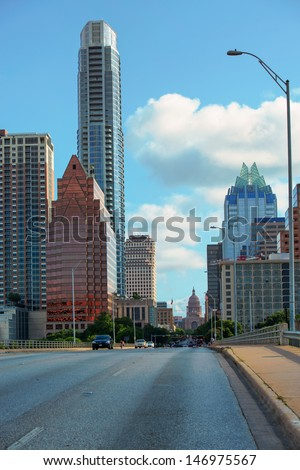 AUSTIN,TX/USA - JULY 9 Downtown Austin, Texas showing the State Capitol building at the end of the street on July 09, 2013. Austin is experiencing a population explosion since the 2008 crash.