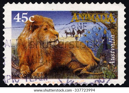 AUSTRALIA - 1996: A stamp printed in Australia shows Male Lion, Zebra, Peacock & Frog, Picture Books of the Year Awards, Childrenâ??s Book Council, circa 1996 - stock photo