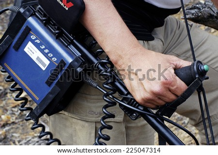 AUSTRALIA - APRIL 24: Detail of holding a metal detector to avoid Australian arm problems because it is very heavy, April 24, 2007. - stock photo