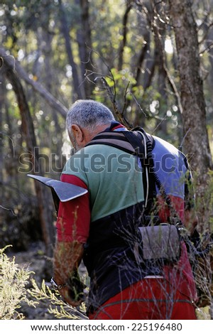 AUSTRALIA - APRIL 23: Gold miner at work detecting gold nuggets with a metal detector., April 23, 2007 - stock photo