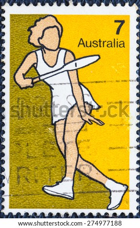 AUSTRALIA - CIRCA 1974:A Cancelled postage stamp from Australia  illustrating Australian Sports Shows a women plays badmintonl,  issued in 1974. - stock photo