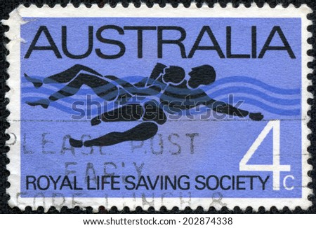 AUSTRALIA - CIRCA 1966:A Cancelled postage stamp from Australia illustrating 75th anniversary of Royal Life Saving Society, issued in 1966. - stock photo