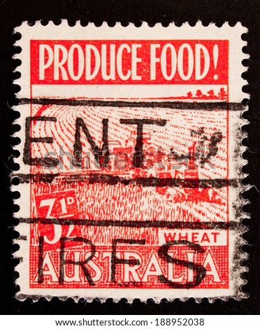 AUSTRALIA - CIRCA 1953:A Cancelled postage stamp from Australia illustrating wheat production , issued in 1953