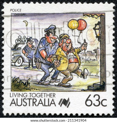 AUSTRALIA - CIRCA 1988: A 63 cent stamp from Australia shows image celebrating the police, from the Living Together series, circa 1988 - stock photo